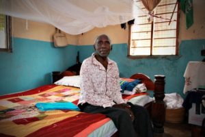 Mr. Issa Ali is a resident in a home for the elderly in Tanzania. The Mission Quilt that he received from Lutheran World Relief is draped across his bed.